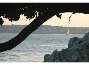 Reading a book or watching the sailboats from a beach on this Maine island is a favorite summer pastime.