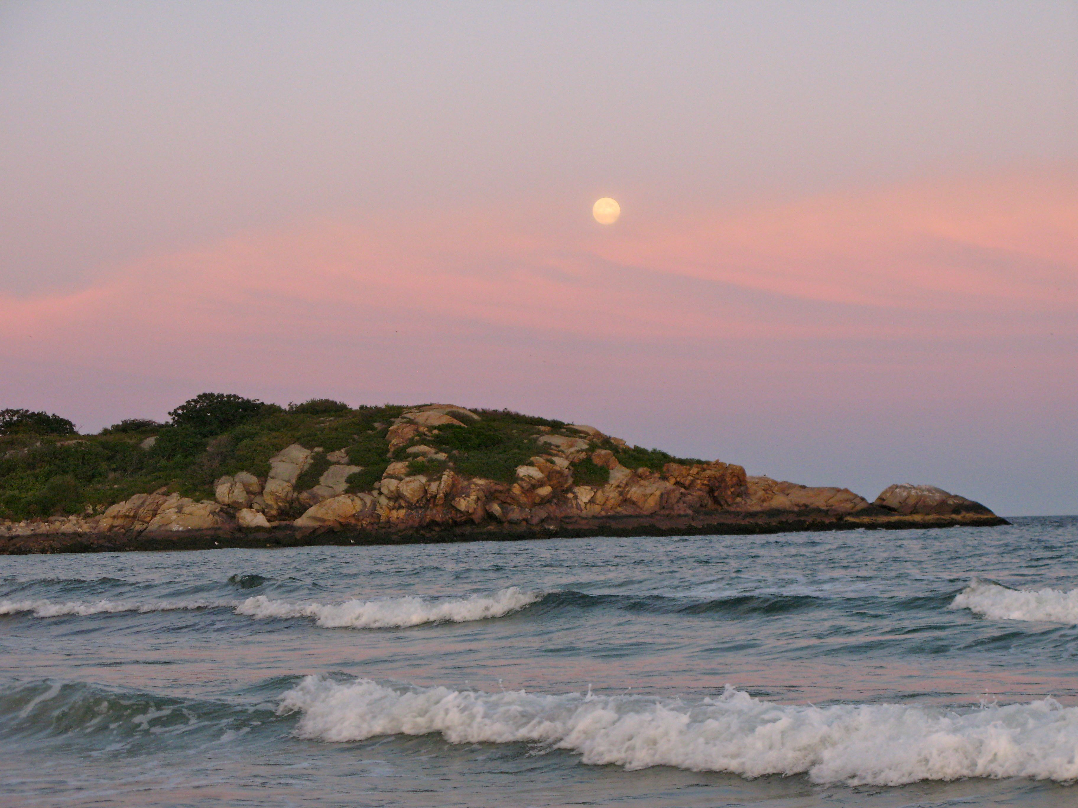 As the sun set, the moon rose over Salt Island in Gloucester.