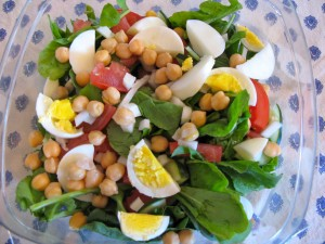 Protein for a dinner salad can come from a variety of sources, including eggs, fish, beef, and chicken.