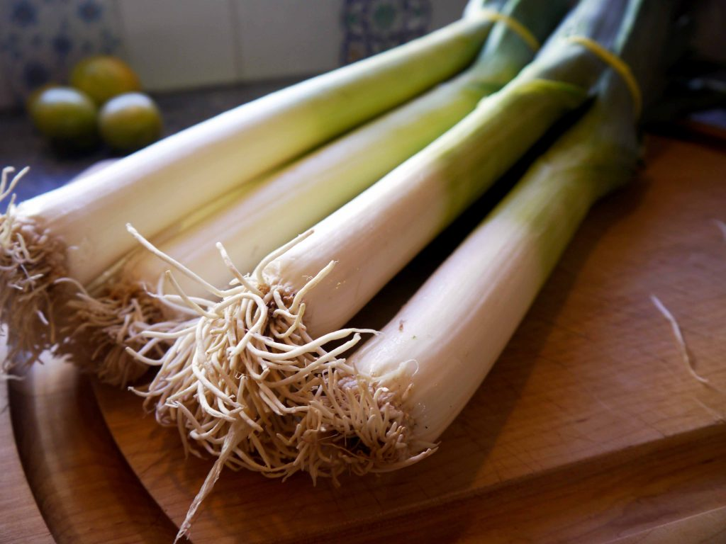 Leeks on a cutting board.