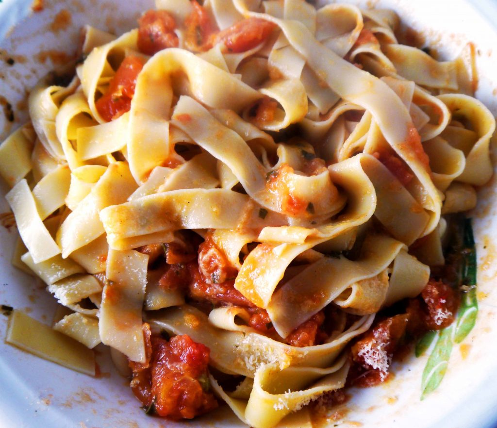 Bowl of pasta with tomato sauce.