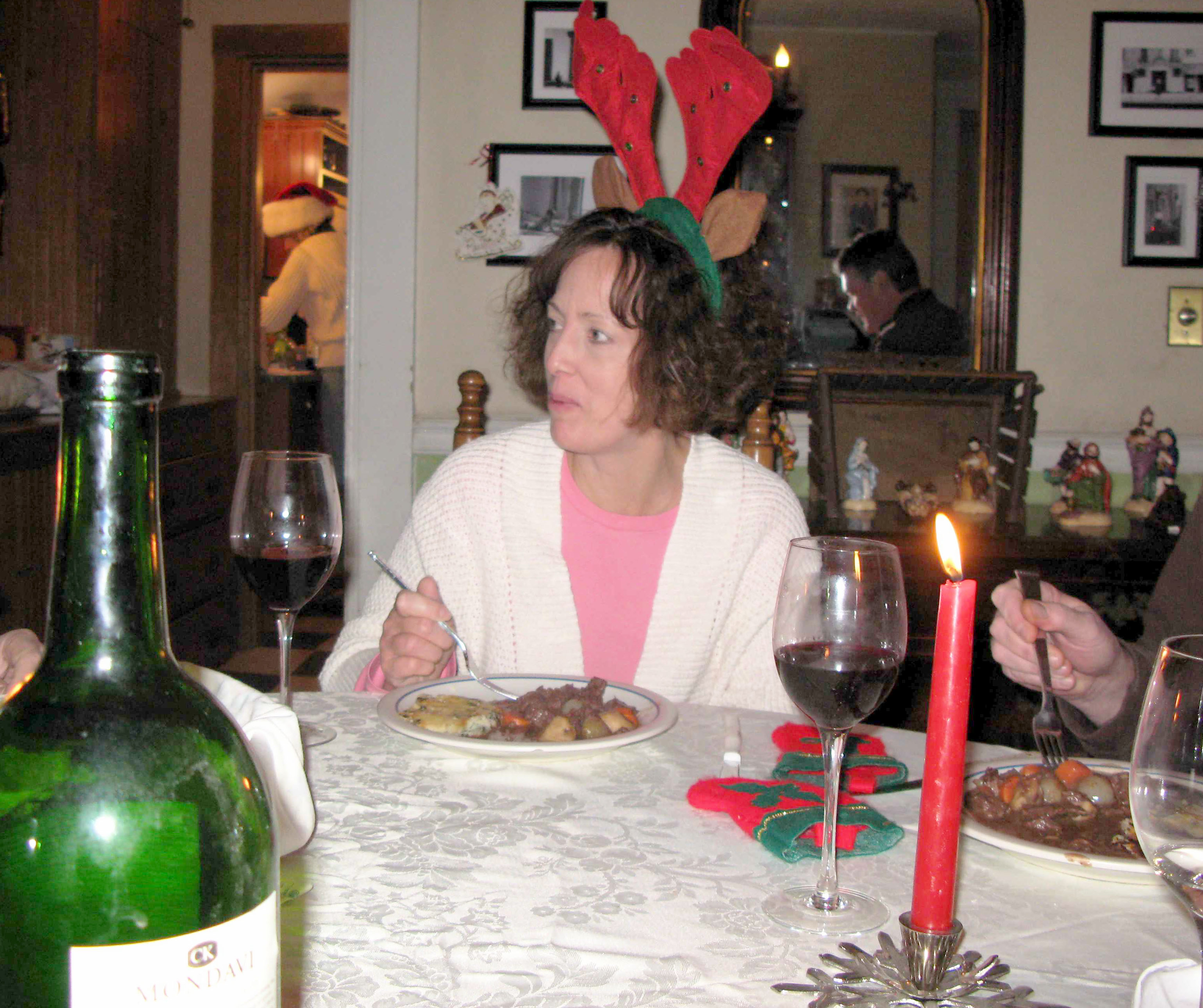 Woman wearing reindeer antlers.