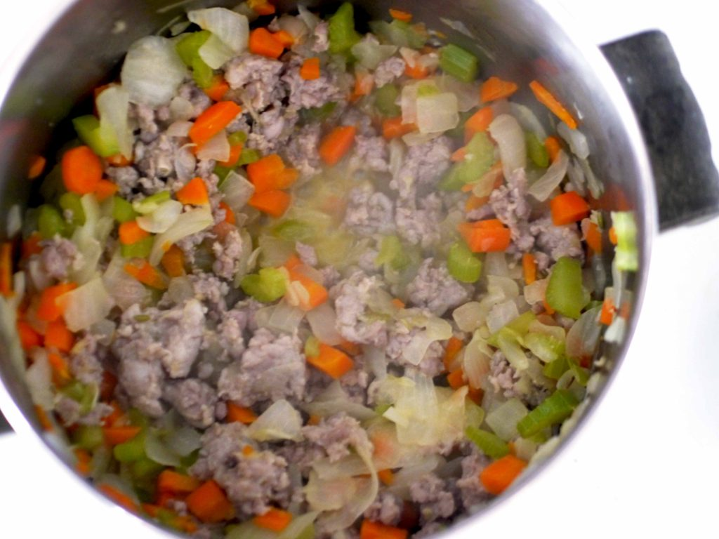 Sausage and vegetables cooking