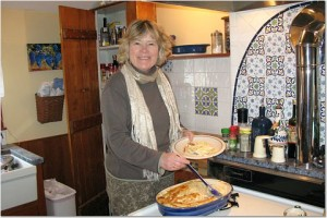 Trish helps herself to some Adult Macaroni & Cheese in the RootsLiving kitchen.