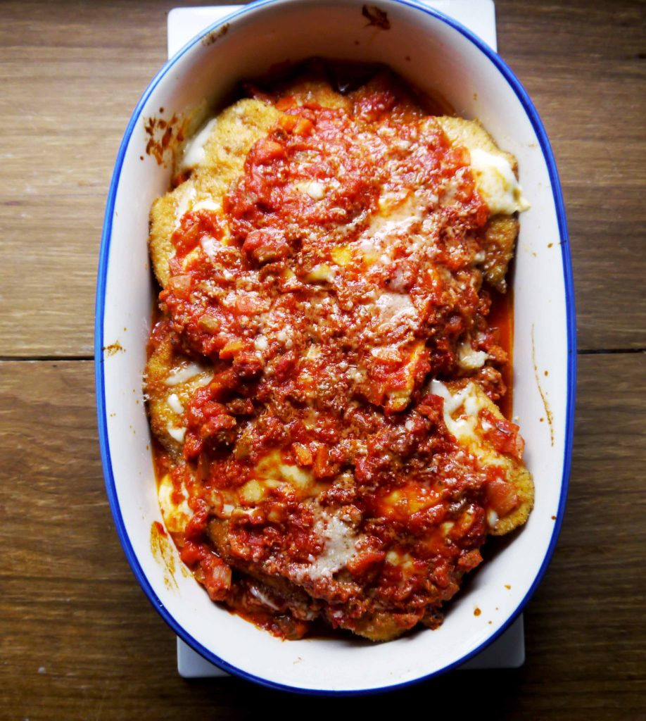 A platter of chicken parmigiana