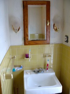 The medicine cabinet, sconces and sink will be replaced.