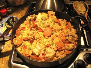 When making paella the rice cooks in the pan absorbing the flavors from everything else.