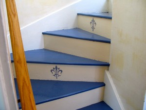 We chose a funky fleur-de-lis stencil to brighten up the old stairway.
