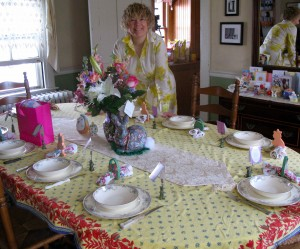 Tricia sets the table in the RootsLiving dining room on Easter Sunday.