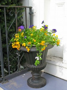Here's a neat trick. This bowl of flowers fit perfectly on top of this urn..