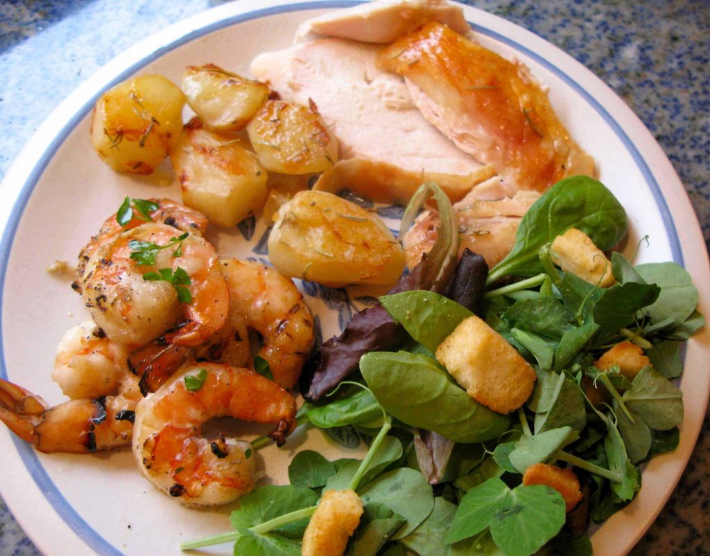 Chicken, roast potatoes, shrimp, and salad