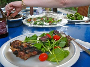 AFTER: A salad made with greens, arugula, fresh mozzarella and grape tomatoes provided a good side dish to grilled chicken.