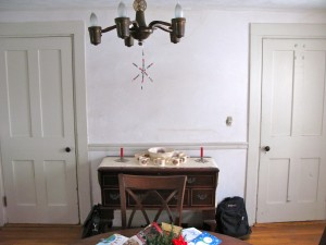 BEFORE: The old dining room after the walls were re-plastered but before the doors were stripped of paint.