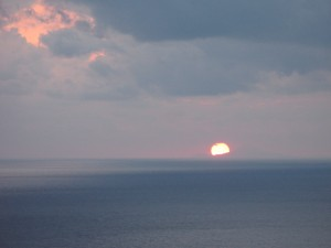 Click on either image to watch a video of the sunset.