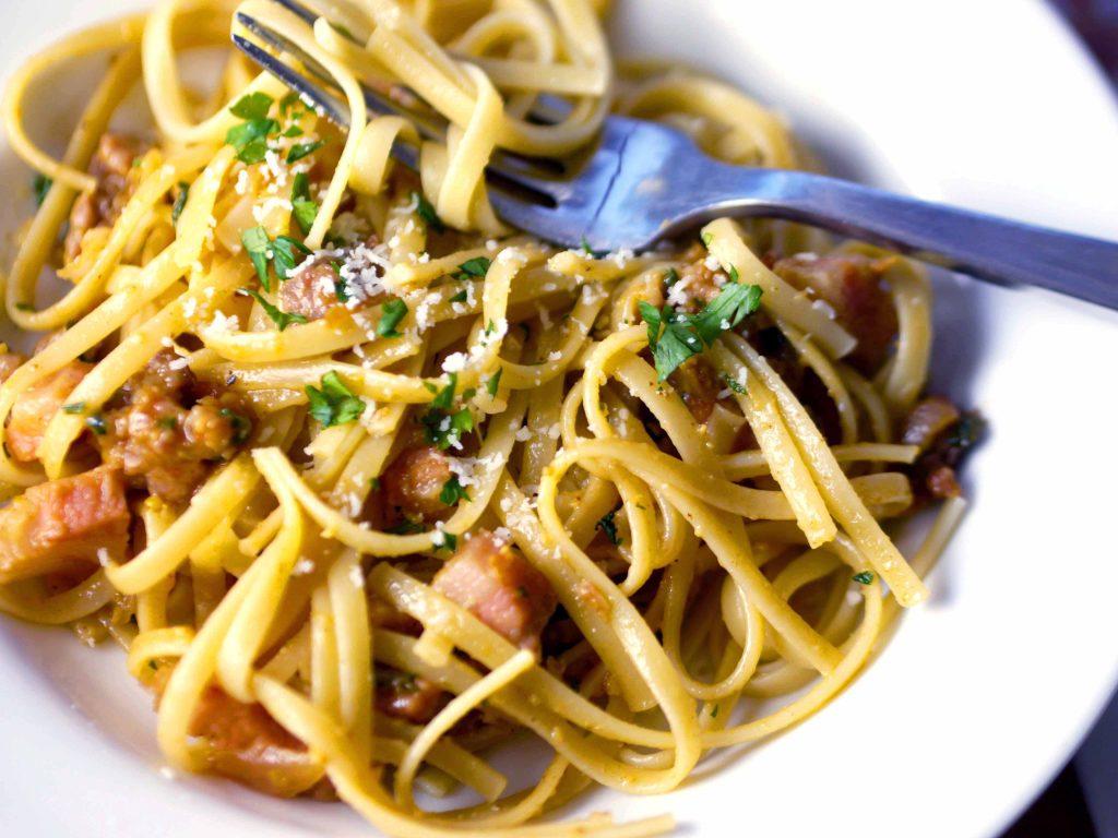 A bowl of pasta carbonara.