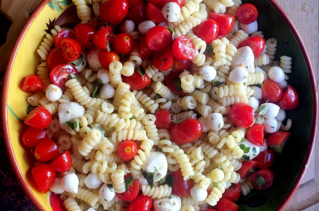 Pasta in a bowl with tomatoes and mozzarella