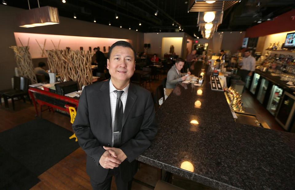 Douglas Tran (top) opened All Seasons Table in Malden in 2007. (Pat Greenhouse Photo/Globe Staff)