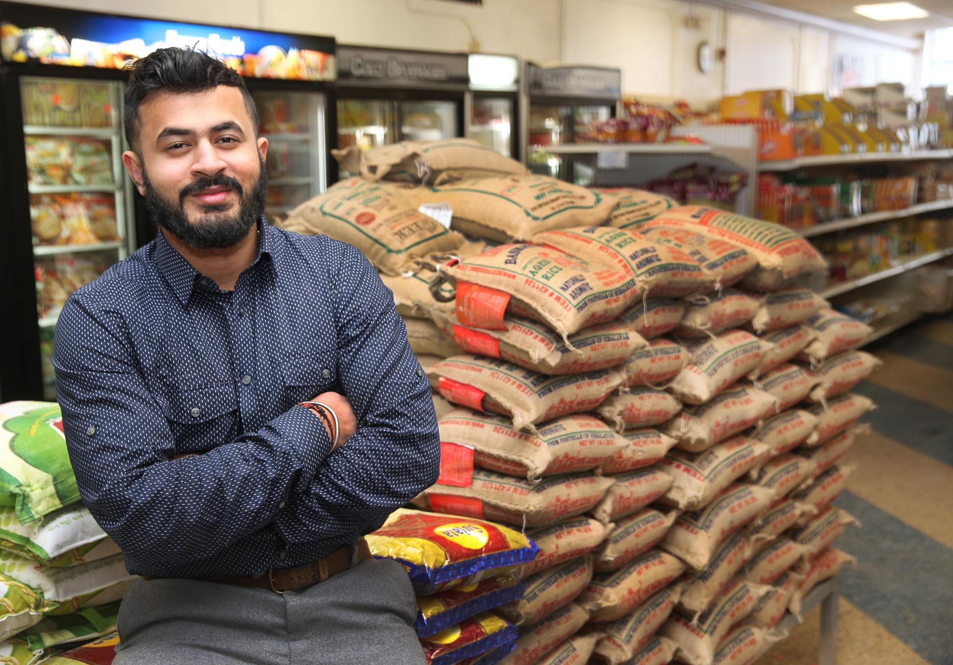 Varun Punj owns Indian Bazaar, a food store, one of the oldest Asian businesses in the city. (Wendy Maeda Photo/Globe Staff)