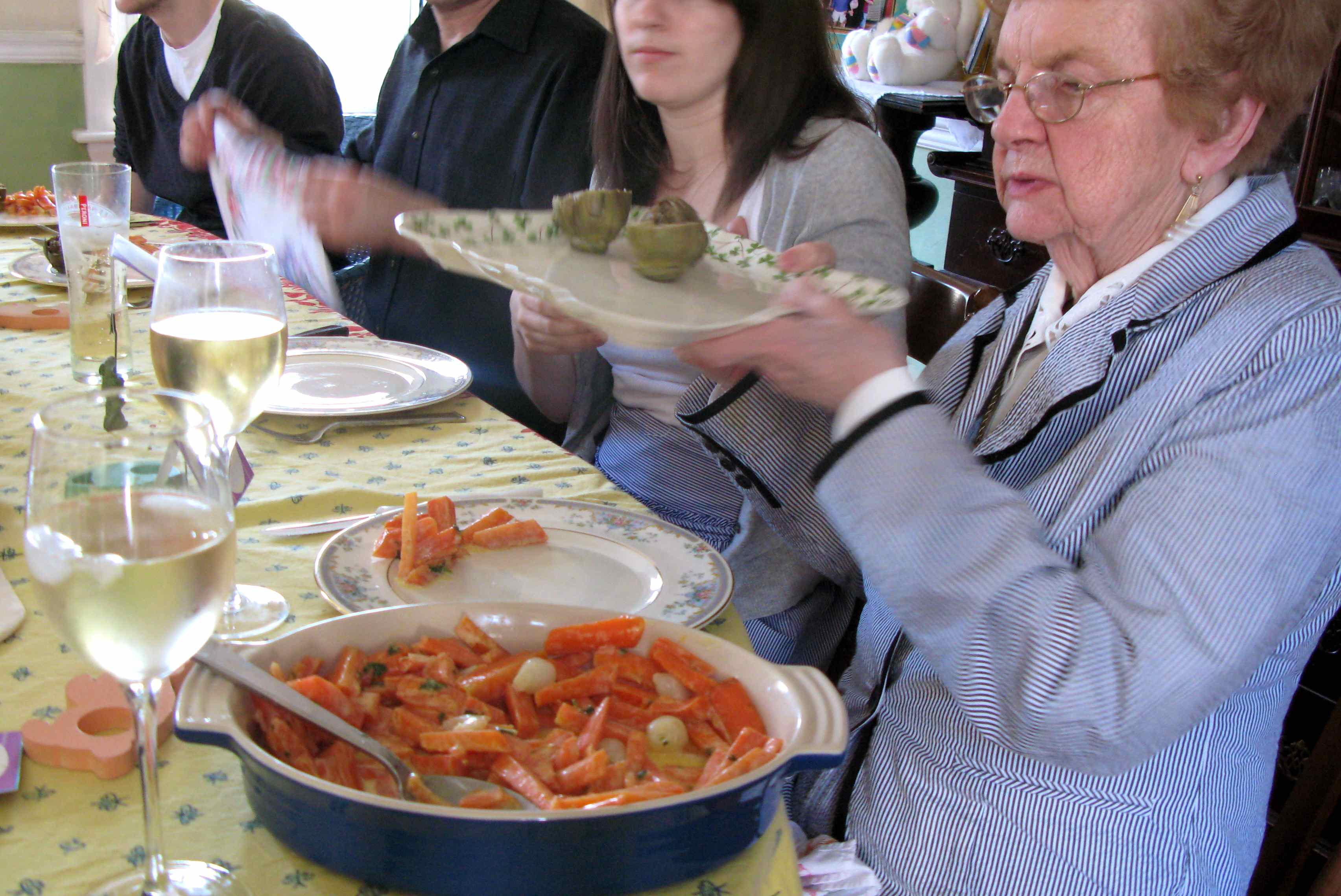The passing of the stuffed artichokes from Easter dinner 2010 in the RootsLiving dining room.