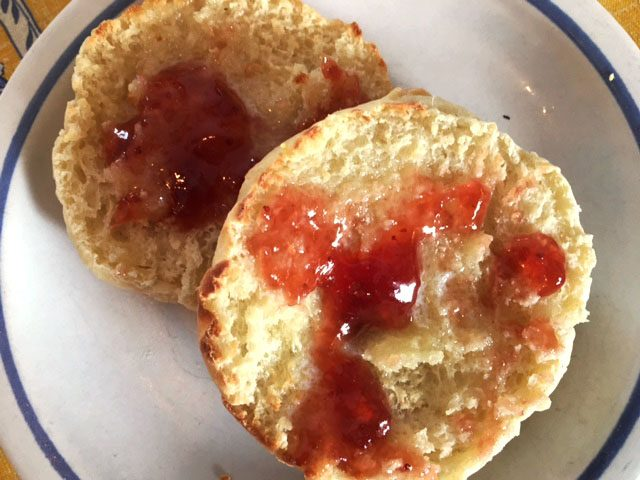 English muffins with butter and strawberry jam