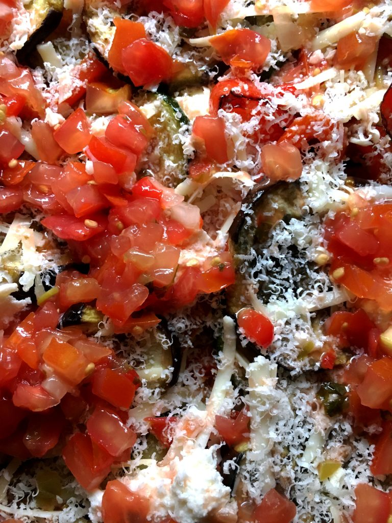 A close-up of salsa, cheese, vegetables