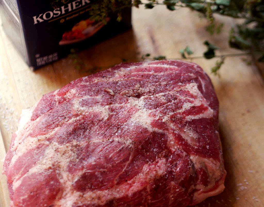 A pork shoulder on a cutting board