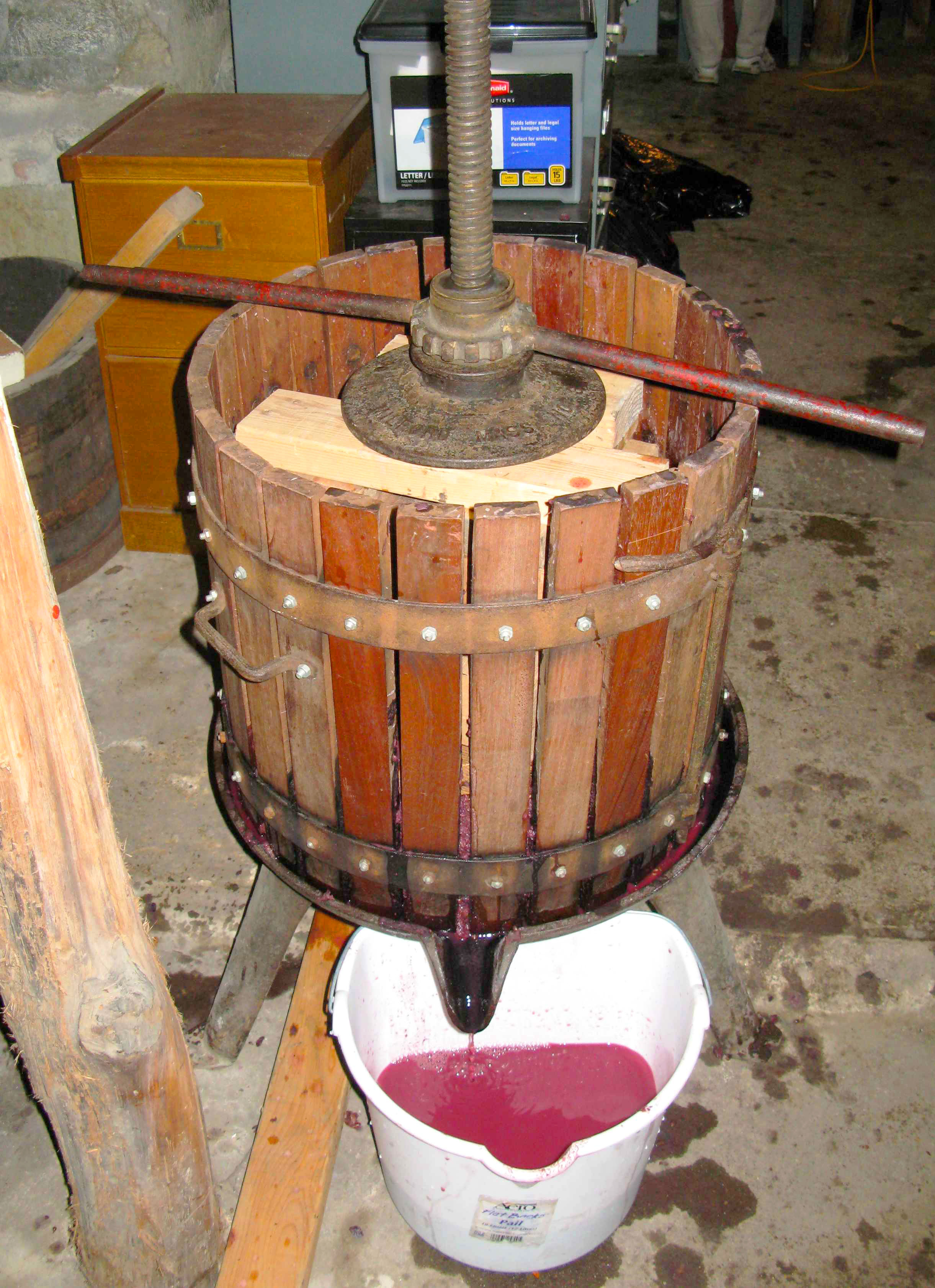 Wine press making juice