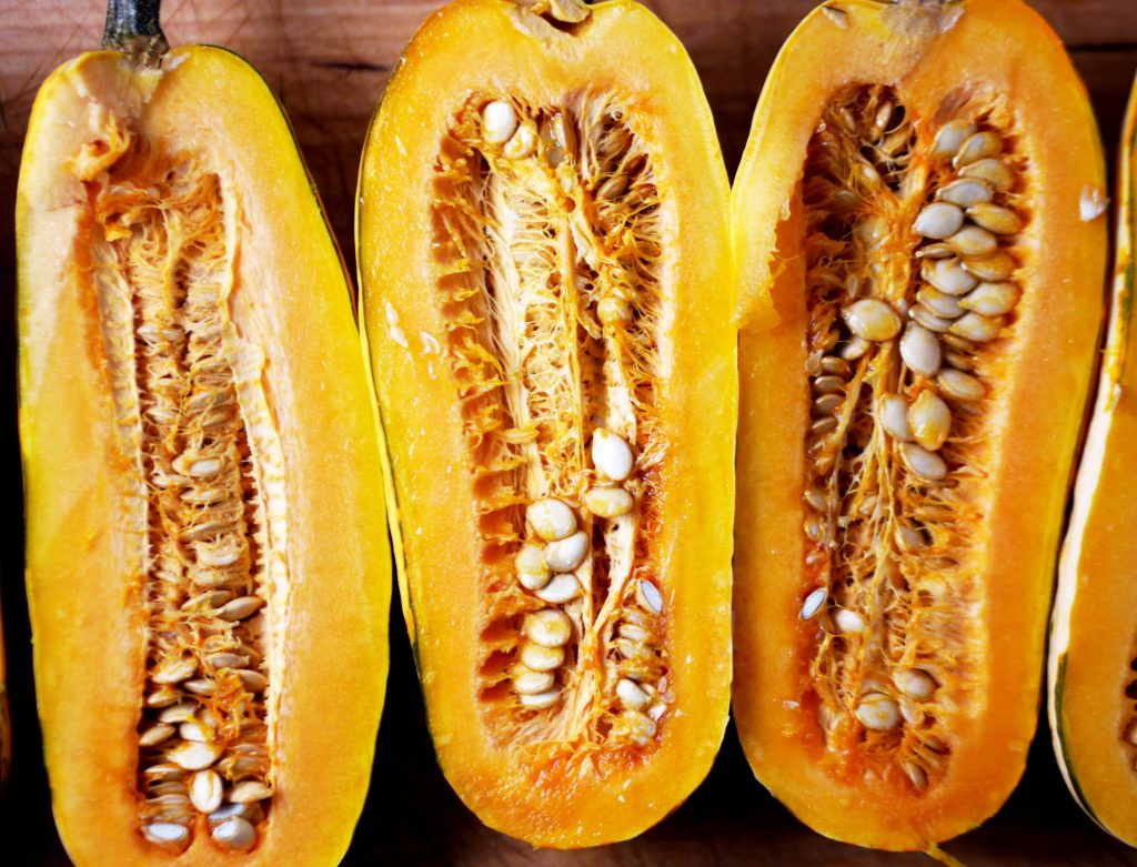 Delicata squash cut vertically in half