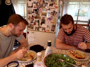Two guys eating dinner