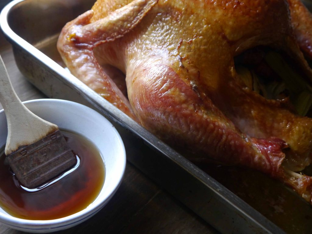 Turkey with a bowl of maple syrup