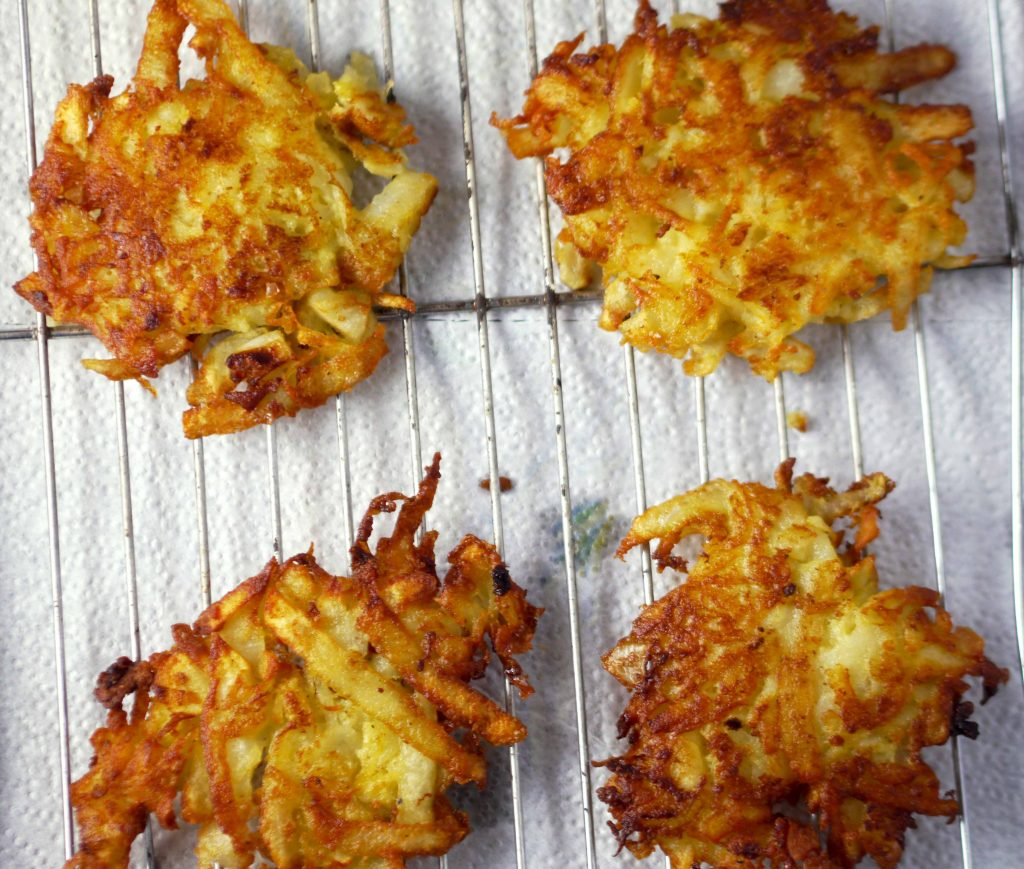 Latkes on a wired rack.