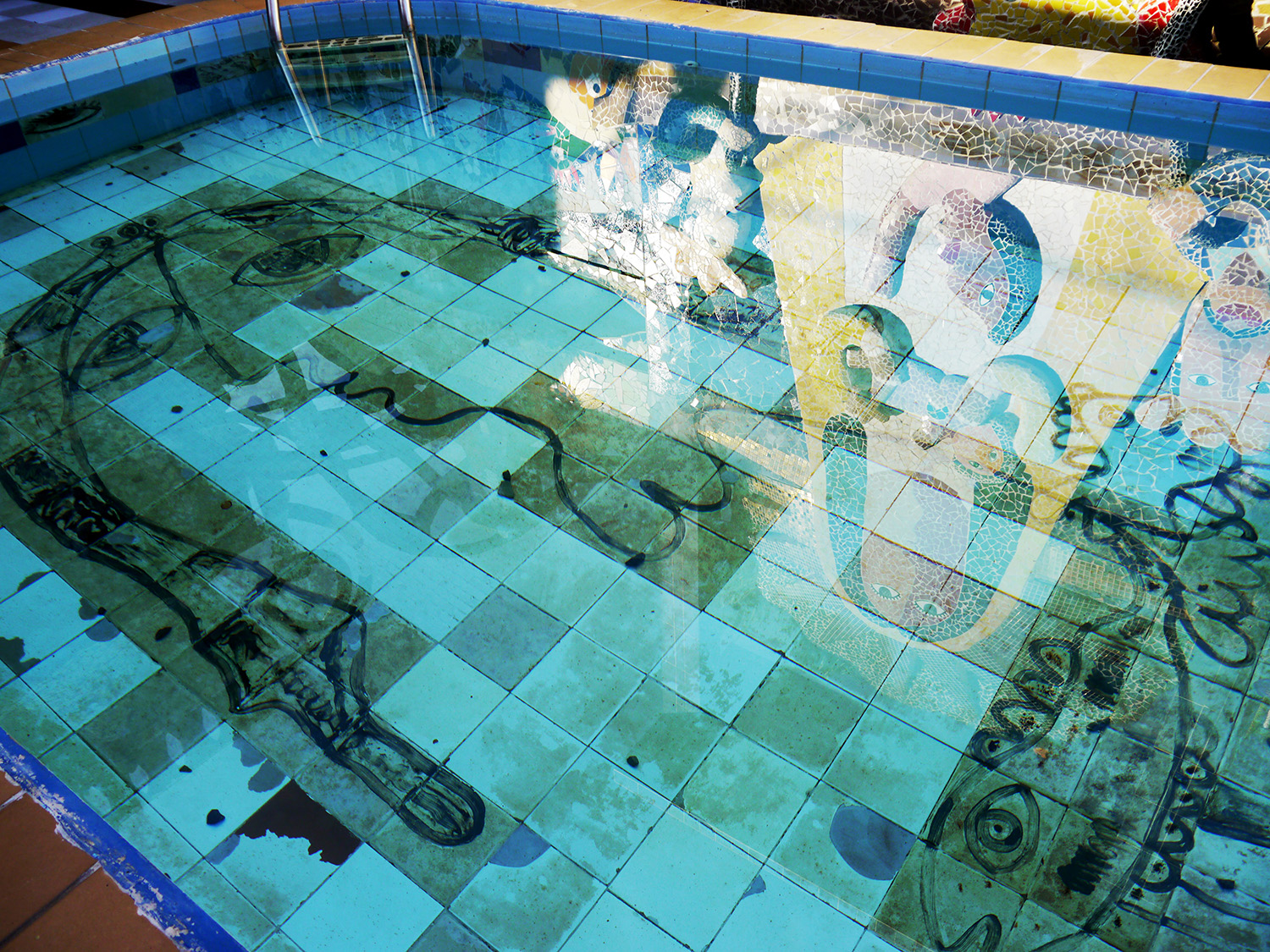 Swimming pool with art painted on the bottom.