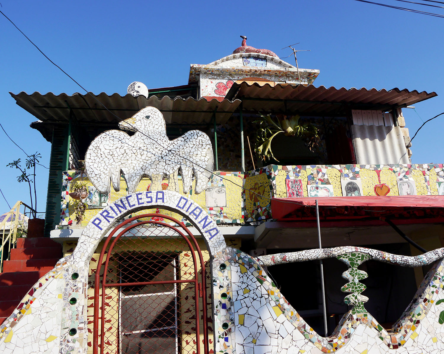 Close up of a home with a mosaic bird.