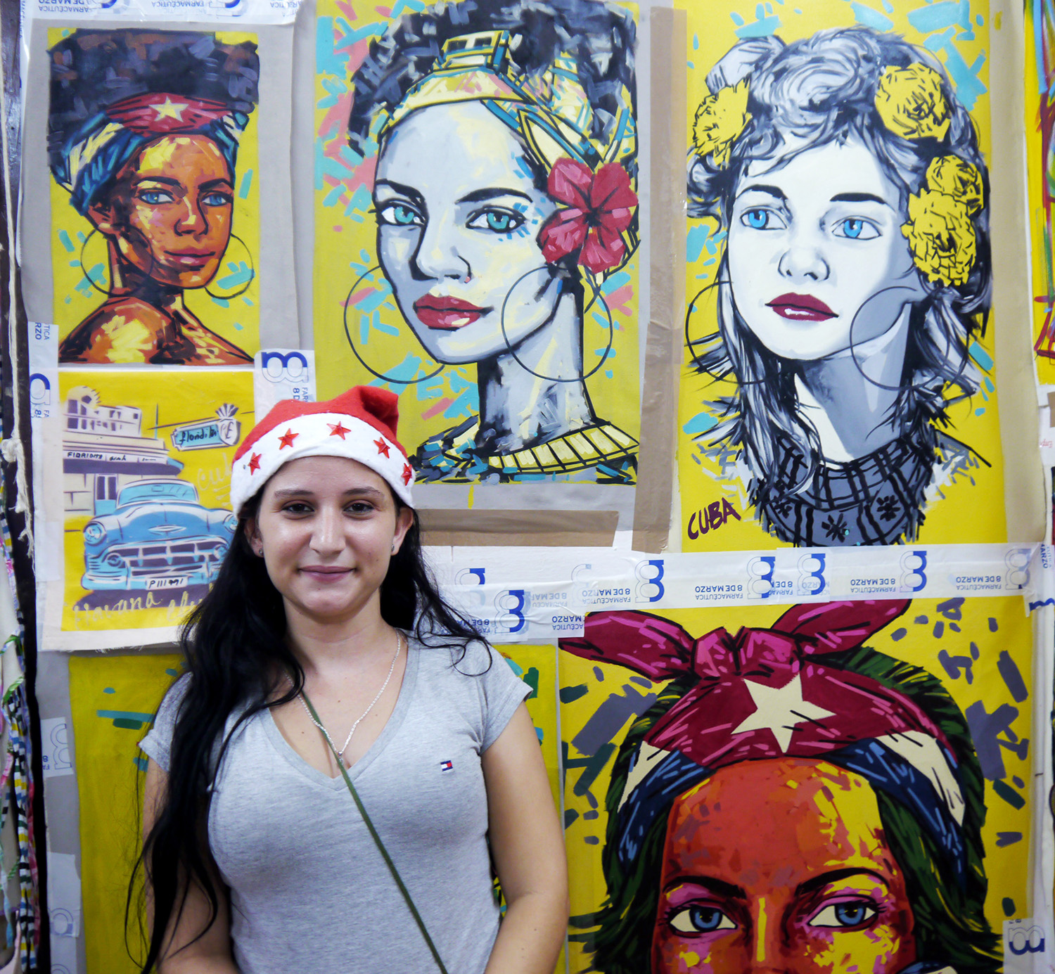 A woman poses in front of artwork.