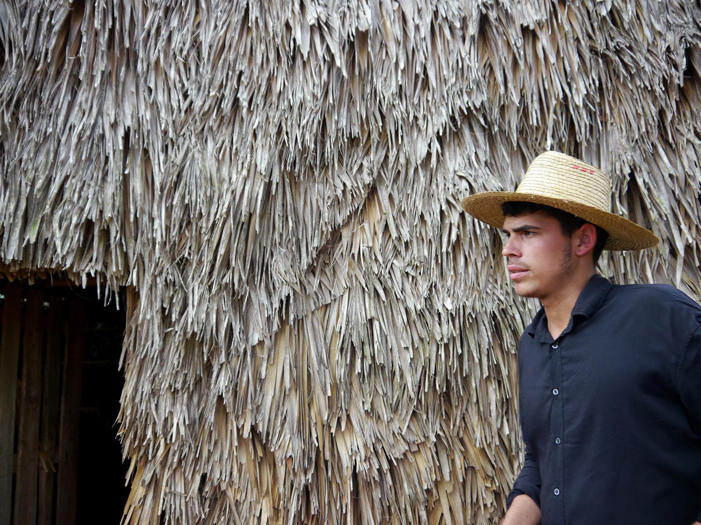 Closeup of farmer outside the air-curing barn.