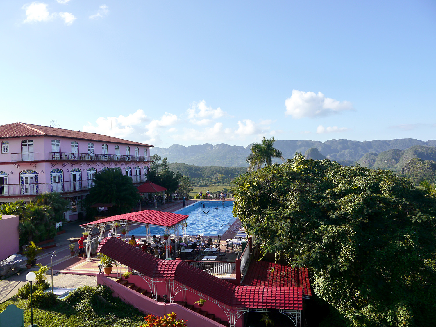 A hotel with large swimming pool beneath the hills of Vinales.