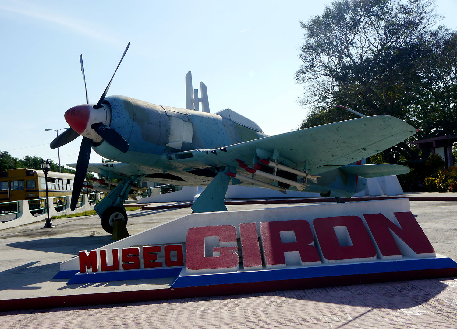 A plane and museum sign.