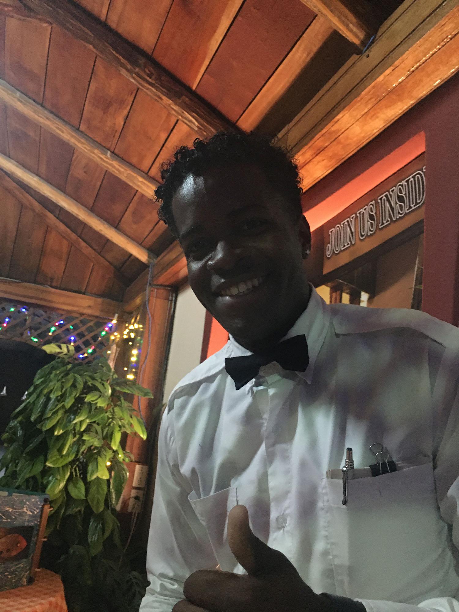 A waiter smiles.