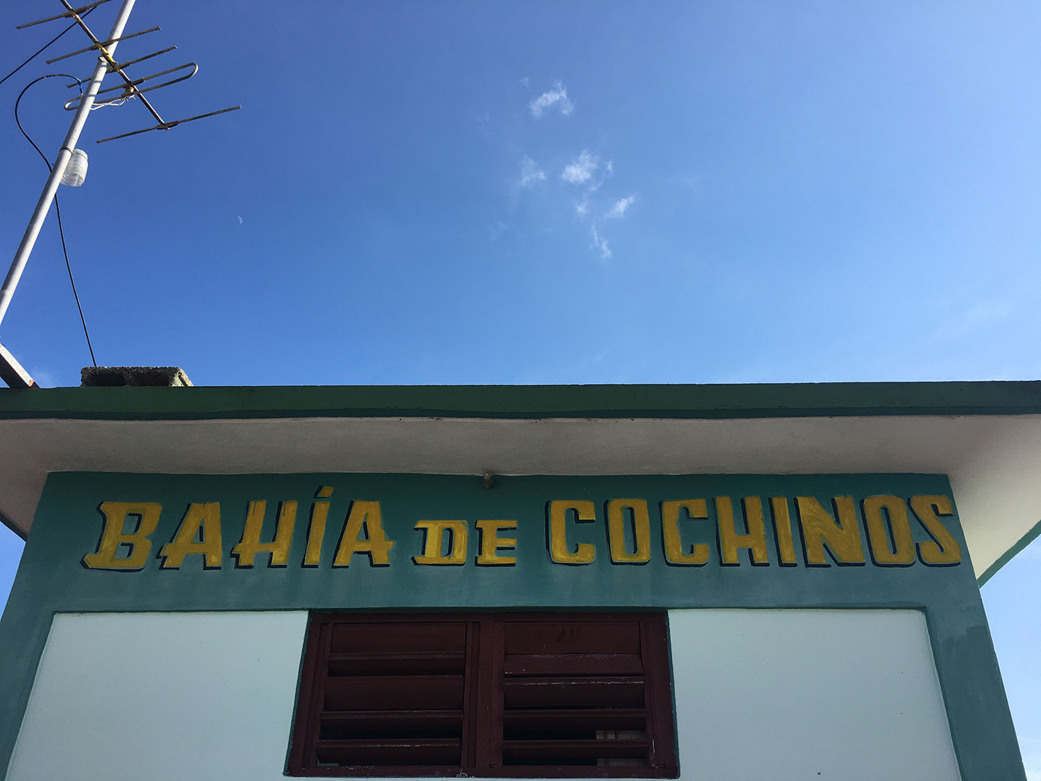 """A sign on a building reads: """"Bahia de Cochinos"""""""