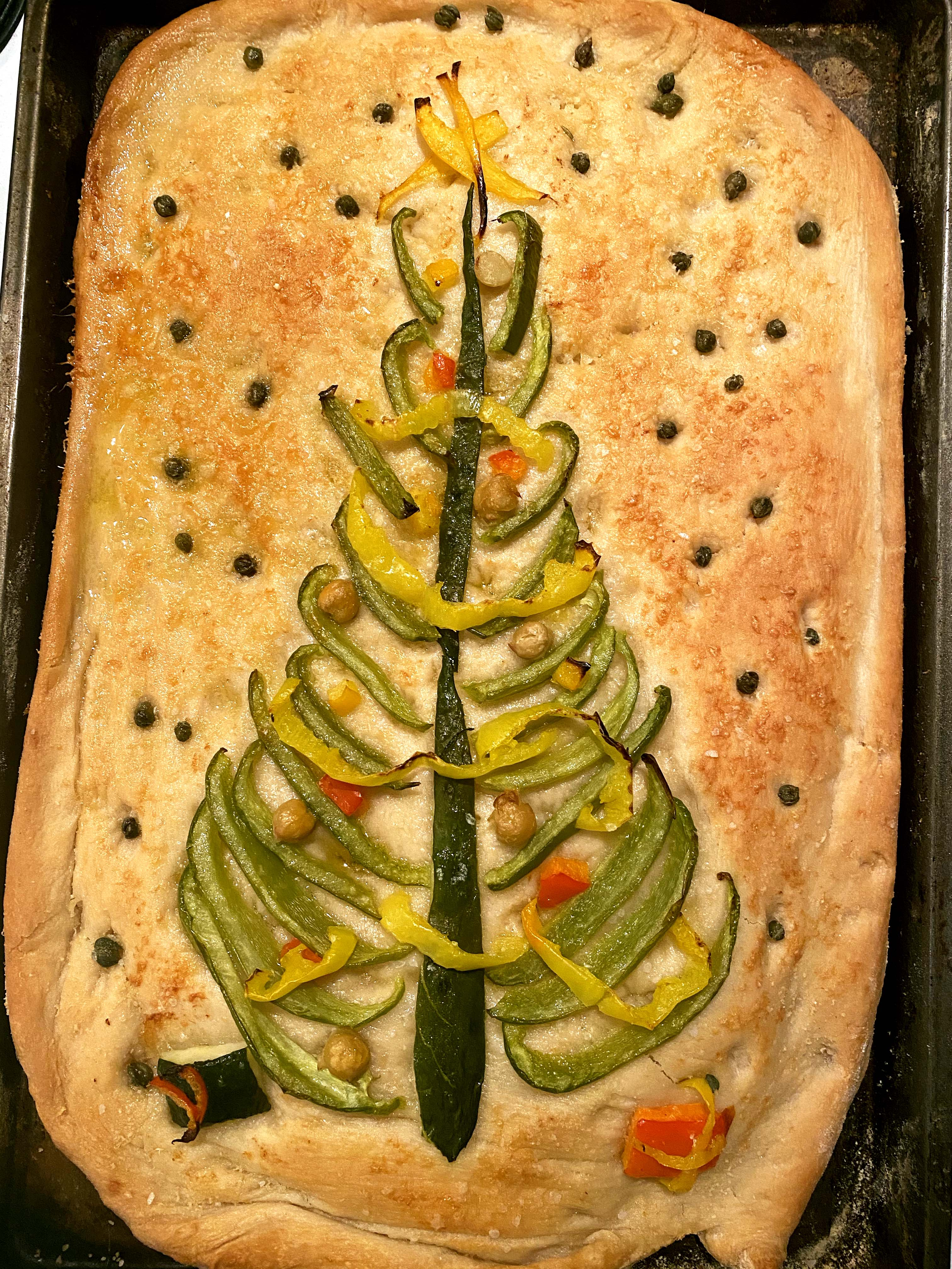 A Christmas tree on a focaccia.