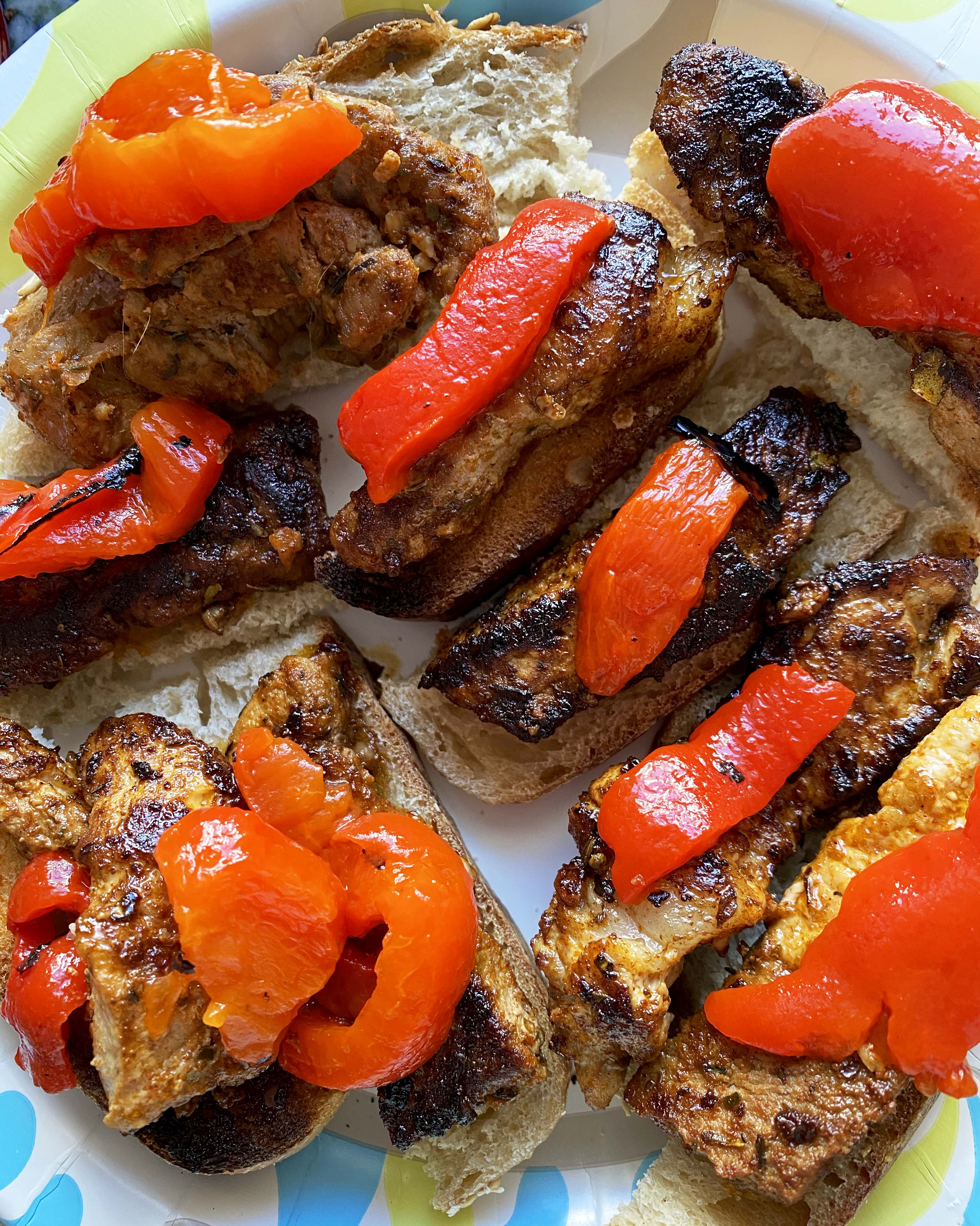 Marinated Pork Canapes topped with red peppers.