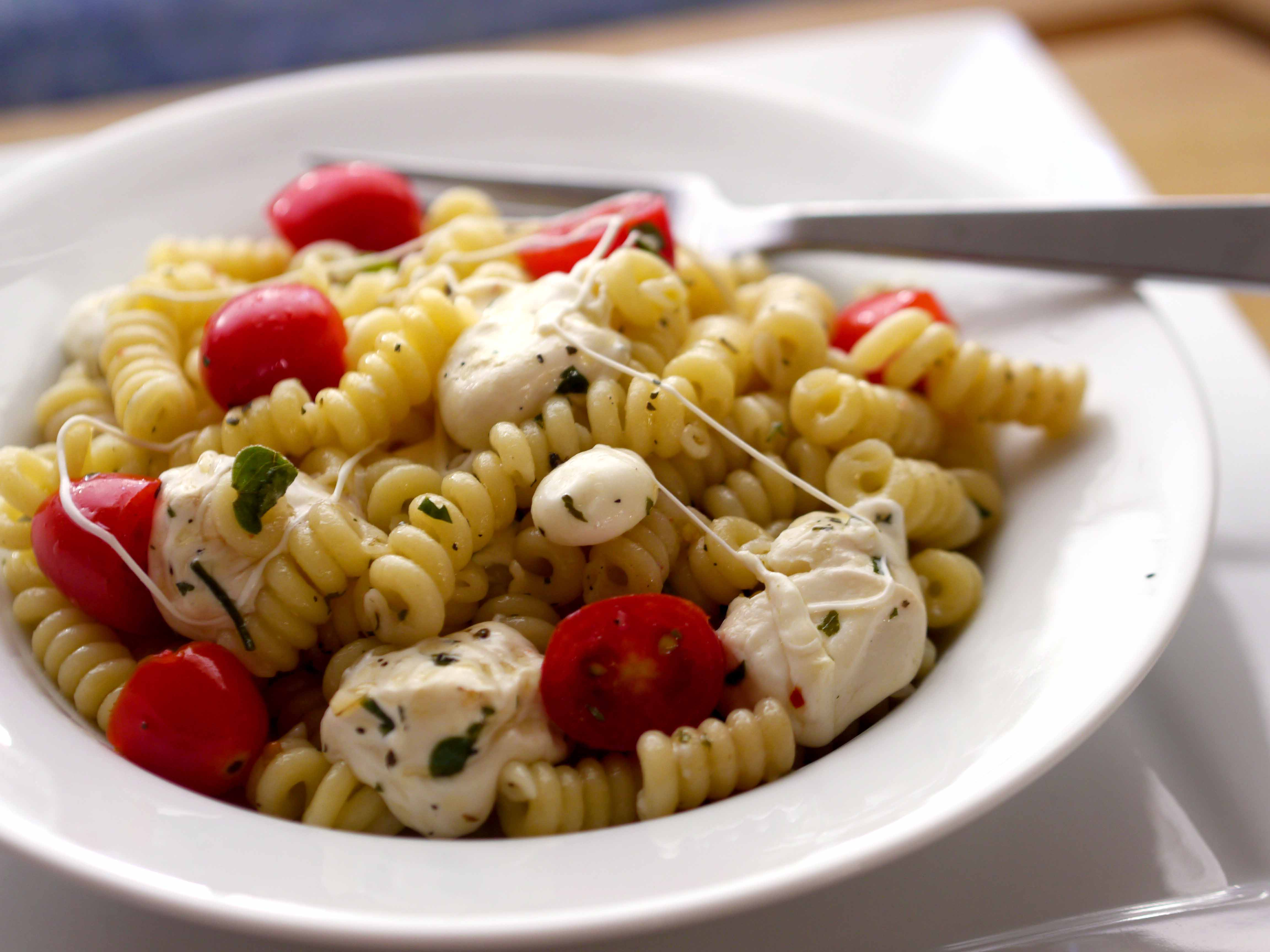Pasta with melted mozzarella cheese