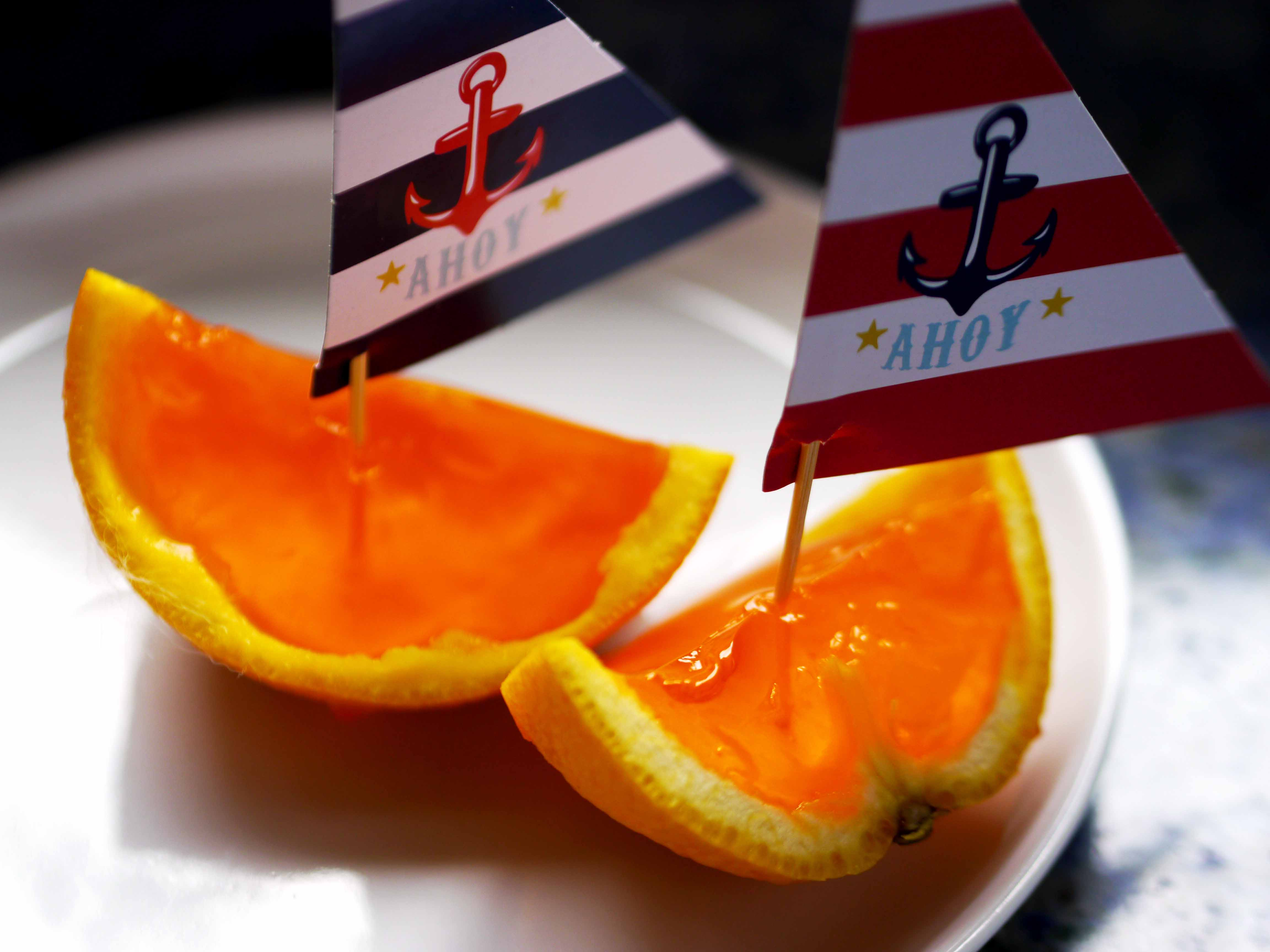 Sailboats made out of oranges